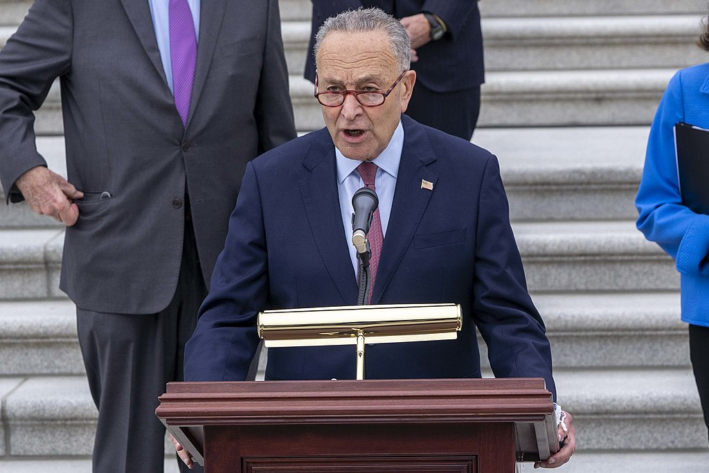 Senate Majority Leader Chuck Schumer at a podium