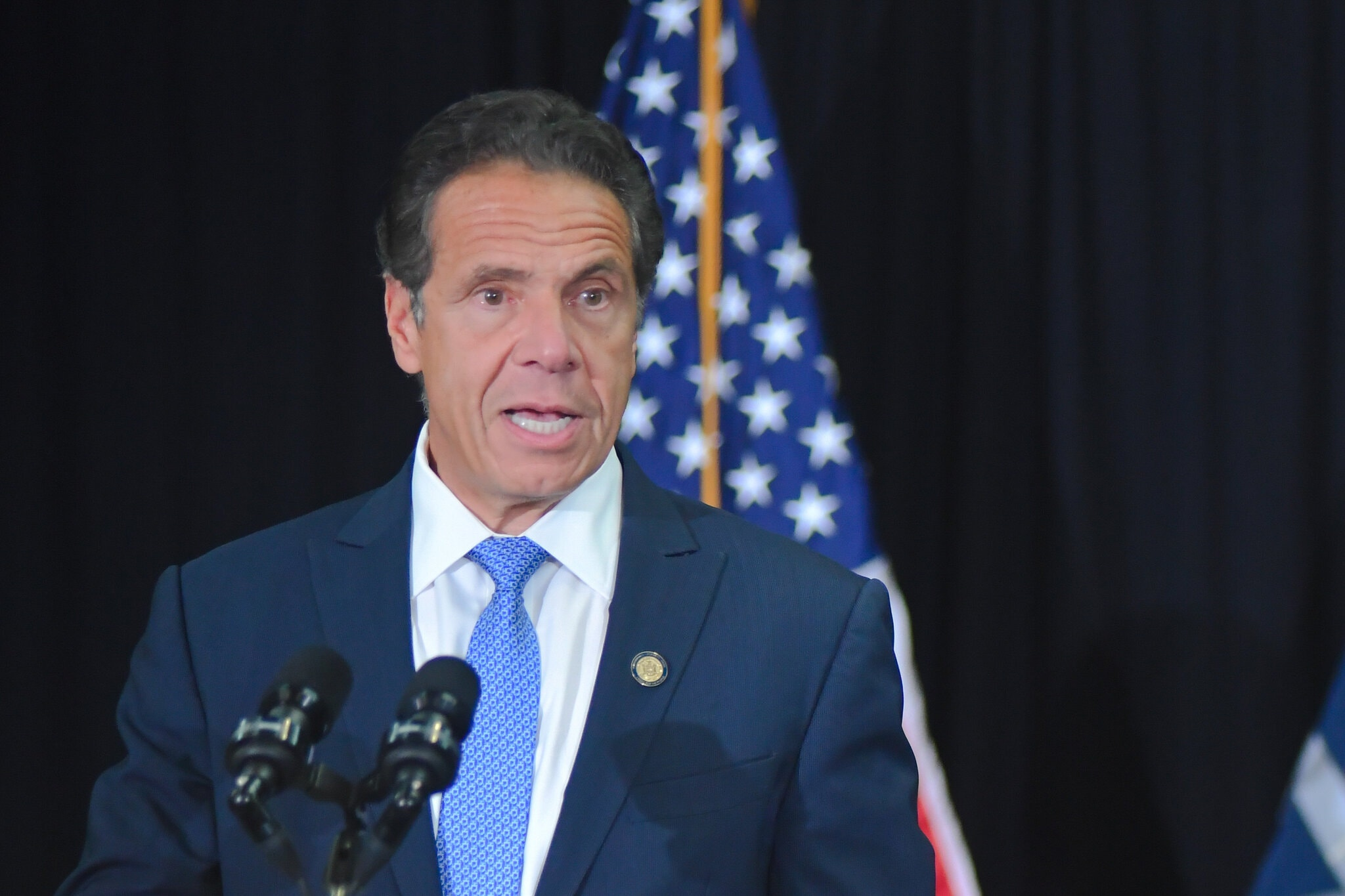 New York Governor Andrew Cuomo at a podium